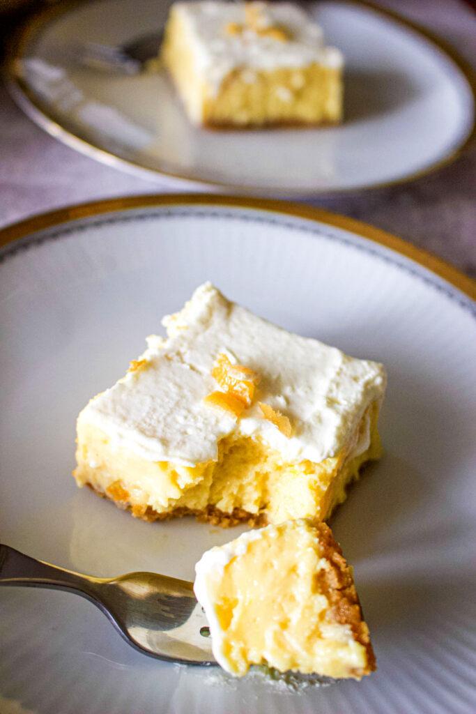 Slice of lemon bar on white plate0